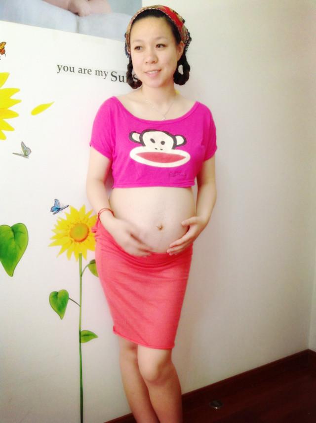孕33周,沐浴在向日葵下的孕照。